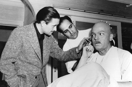 Gregg Toland (left) checks out Welles as he is transformed into Kane as an old man by make-up artist Maurice Seiderman.