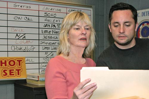 Mary Rae Thewlis and location manager Tom Ross plan the day's work on Law & Order set.
