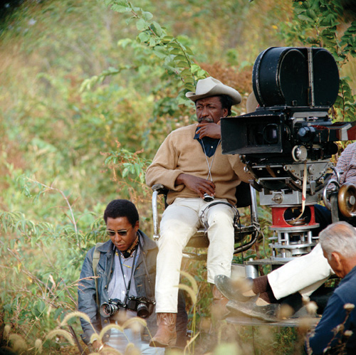 ROLE MODEL 2: Gordon Parks Jr. at the feet of his father while filming The Learning Tree. - photo © Warner Bros./Seven Arts, Inc.
