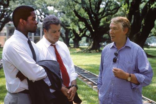 Nichols with Adrian Lester and John Travolta in Primary Colors (1998).- photo by Francois Duhamel/Universal Pictures.