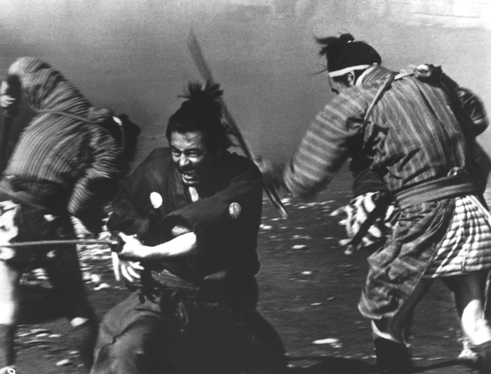 "MIDDLEMEN: At the start of Yojimbo, Kurosawa frames an argument between father and son with Mifune placed strategically between them."" - photo courtesy Criterion Collection - click link for IMDB info."