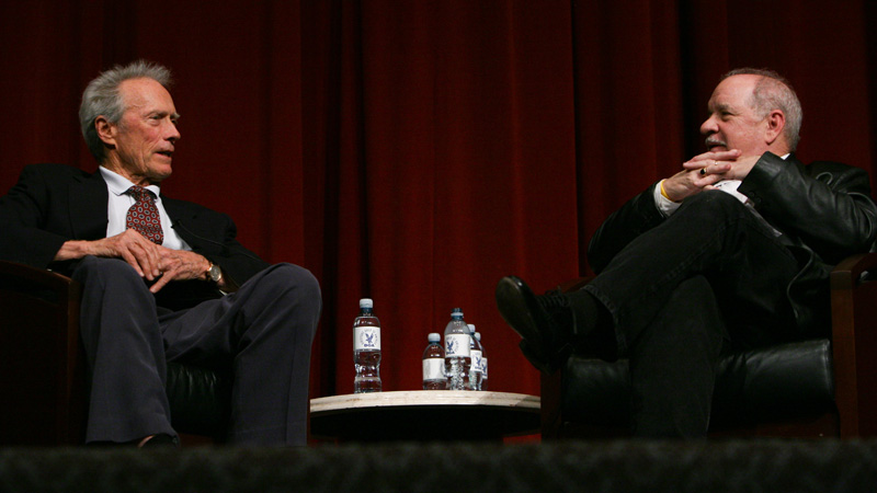 Director Clint Eastwood onstage with moderator Paul Schrader.