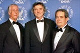 DGA President Michael Apted and National Executive Director Jay D. Roth with 2003 Honoree Curtis Hanson (center).