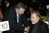 Honoree DeNiro spends a moment at the table of his old friend, actor Harvey Keitel. (Photo by Evan Agostini/Getty Images)
