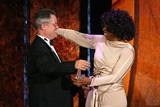 Winfrey presents Demme with the DGA Honors crystal eagle & a big hug. (Photo by Matthew Peyton/Getty Images)