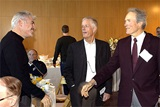 Feature Film Award Nominee Gary Ross greets fellow nominee Clint Eastwood as DGA President Michael Apted (center) looks on.