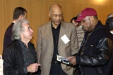 DGA Past President Arthur Hiller, Children's Programs Nominee Oz Scott, and DGA Third Vice President Paris Barclay check the schedule of events.