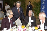 DGA National Executive Director Jay D. Roth (standing), greets 2003 Feature Film Nominee Clint Eastwood, DGA President Michael Apted and Nominee Peter Weir.