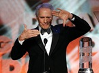 Eastwood models for his Lifetime Achievement Award.