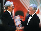 Clint Eastwood accepts DGA Lifetime Achievement Award from DGA President Michael Apted.