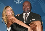 Daytime Serials Award Presenter Chi McBride helps co-presenter Kristin Chenoweth off the stage.