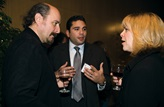 Nominee Yves Simoneau chats with guests at the post symposium reception.