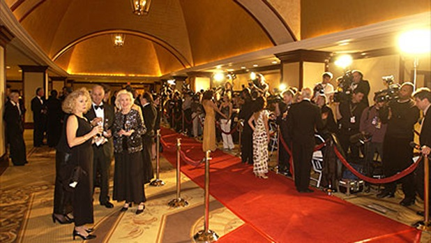 The red carpet at the Century Plaza Hotel is ready to receive the VIPs.