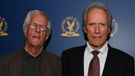Director Clint Eastwood onstage with DGA 75th Anniversary Chair Michael Apted.