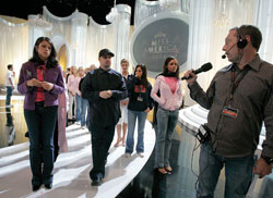 HERE SHE IS: Stage manager Gary Natoli directs traffic at the Miss America Pageant.- photo by AP Images.