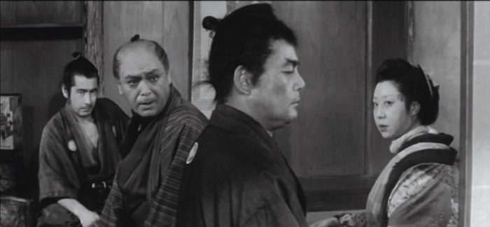 ONE -EYED JACK: Mifune's one good eye is visible in a patch of light after he is beaten and locked up in Kurosawa's Yojimbo (1961). - photo courtesy Criterion Collection