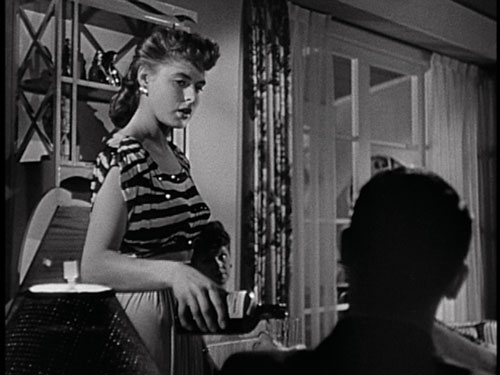 FLIRT: Party girl Ingrid Bergman meets Cary Grant in the film's opening scene, but the audience only sees his back. - Screenpull: RKO/The Criterion Collection - click link for IMDB info